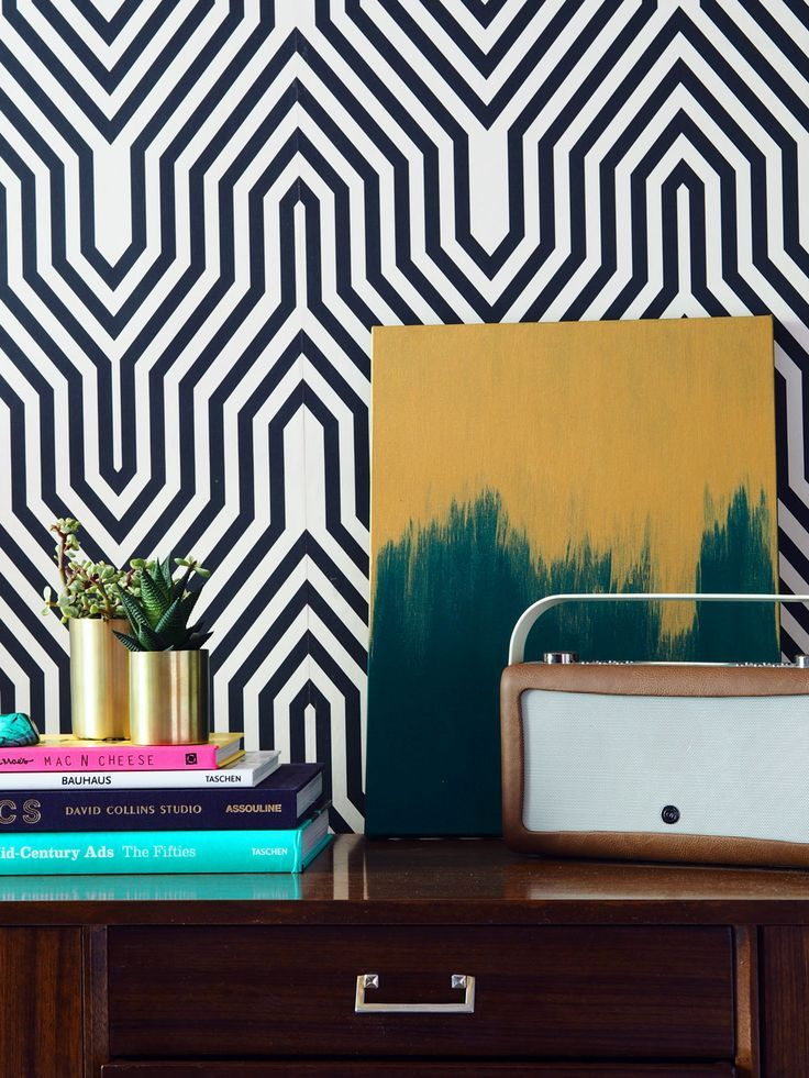 I wanted to show off how this retro looking Bluetooth speaker could be styled on a sideboard alongside modern accessories like this abstract artwork and geometric monochrome wallpaper.