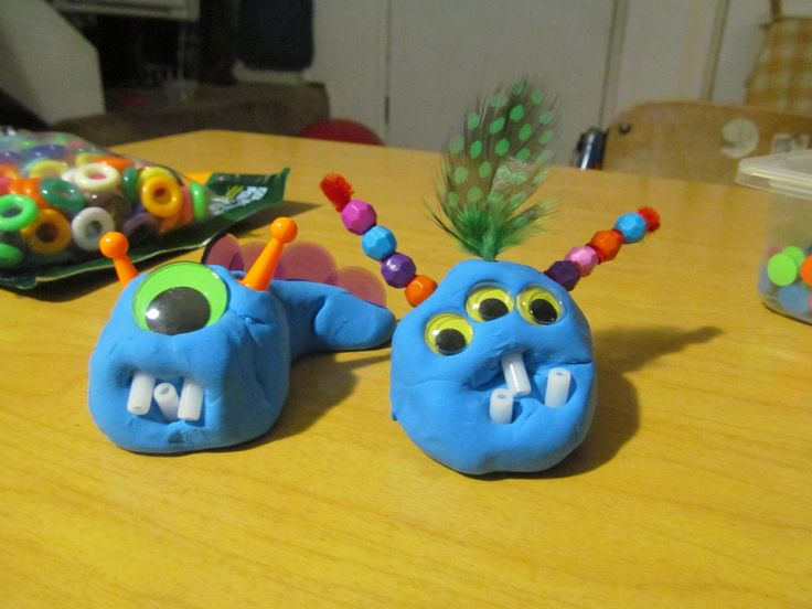 Clay Monsters: we used *Model Magic for body and added goole eyes, feathers, chenille stems and beads. The one on the right my 5 yr old made.