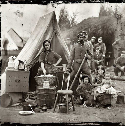 """1861.  """"Some wives insisted on staying with their husbands, which may have been the case with this woman, judging by her housewifely pose alongside a soldier, three young children, and a puppy. In addition to taking care of her own family, she may have worked as a camp laundress or nurse."""""""