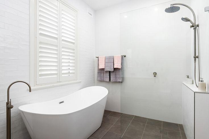 Freestanding bath spout. Freestanding bath. Twin shower. Brushed nickel tap-ware.