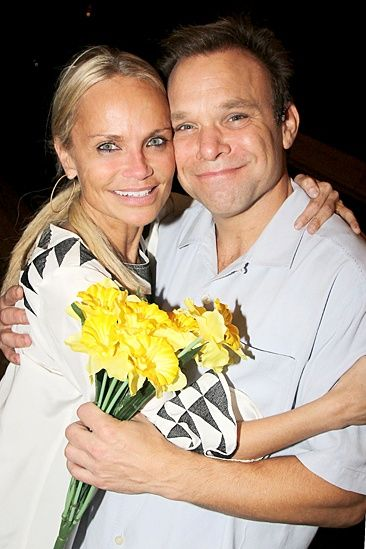 Kristin Chenoweth presents Norbert Leo Butz with a bouquet of Big Fish signature flowers, daffodils!