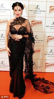 'Burlesque Queen' @Dita Von Teese in a gorgeous black net #Saree teamed with a sequinned bustier designed by @Shivan_Narresh - http://shivanandnarresh.com/ at a promotional event in New Delhi, Nov 20, 12