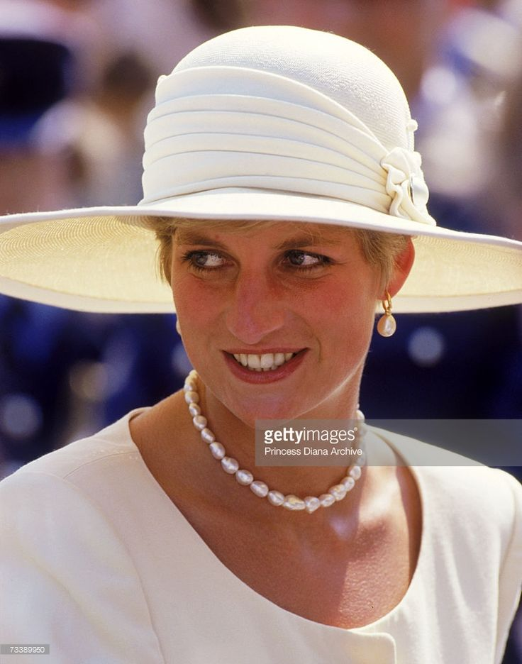 The Princess of Wales visits RAF Cranwell in Lincolnshire on her 10th wedding anniversary, July 1991. She is wearing a cream Catherine Walker suit and Philip Somerville hat.