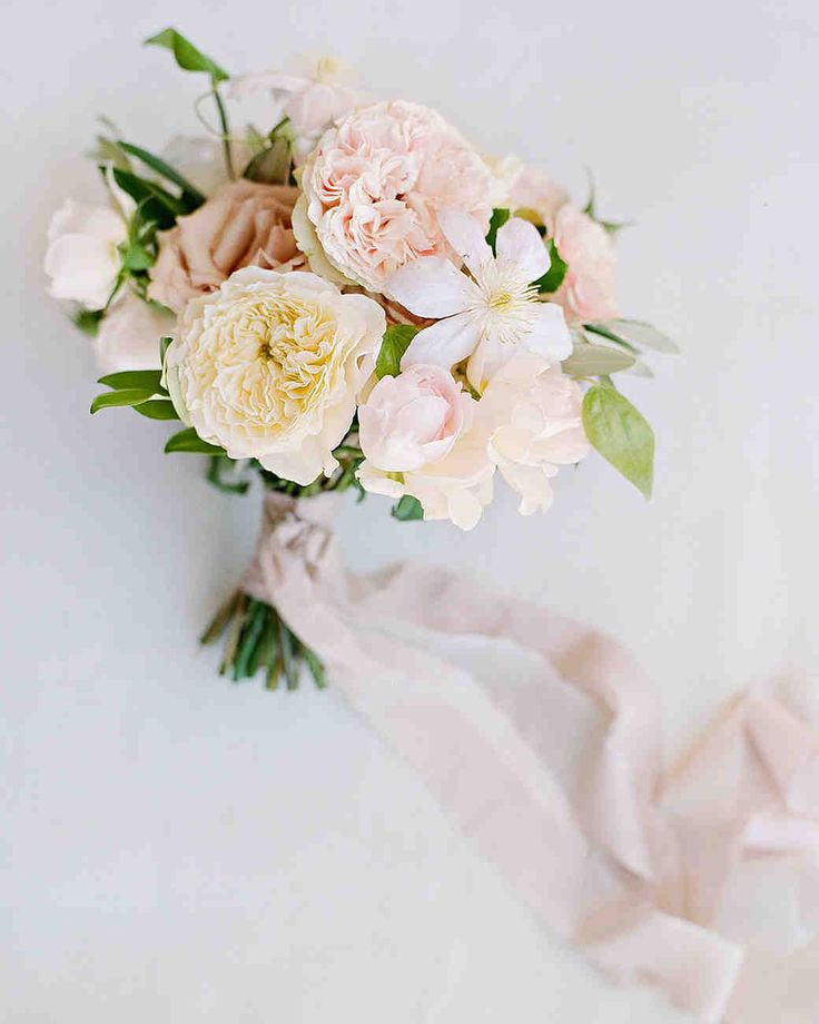 A Malibu Wedding With a Surprise Reception Location | Martha Stewart Weddings - Several varieties of garden roses in shades of pale pink and cream were used throughout the wedding in a romantic, just-picked style. Aislinn's bouquet by Oak & the Owl, also included clematis.
