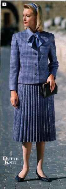 Pleated Skirt Suit. Love the bow blouse.