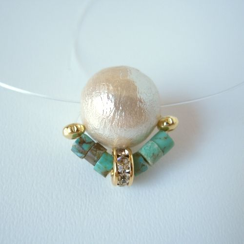 Highlight a simple pearl with bead embellishments.