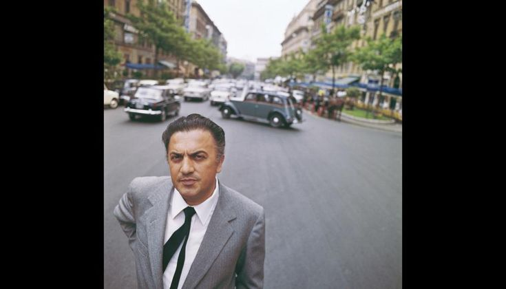 Federico Fellini during a photo shooting in Via Veneto, Rome. Photo by Gianfranco Moroldo/Archive Rcs #1