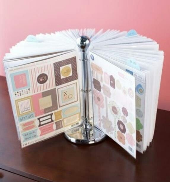 Paper towel holder, binder hooks, and clear pages! Awesome way to display kids stuff!
