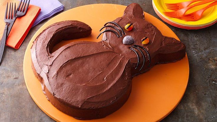 Frighten away those chocolate urges with this hauntingly delicious chocolate cake cut and frosted to look like a black cat.