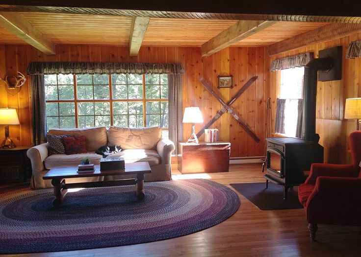 Alicia and her husband restore the knotty pine in their 1955 cabin - so inviting! - Retro Renovation