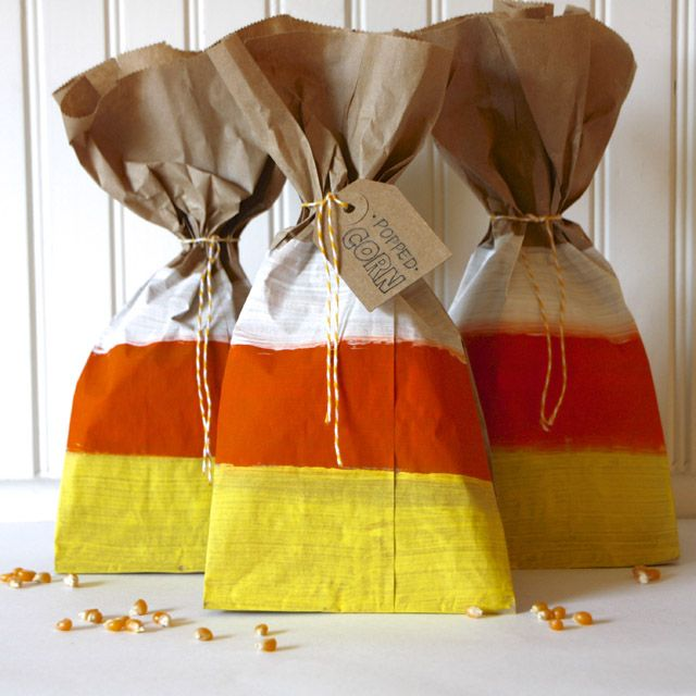 I love these candy corn painted popcorn treat bags!  They are so fun and are a healthy treat. (We Have Aars) #Halloween #Snack #healthy