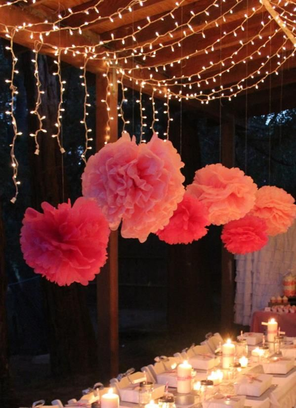 Like the Pom poms, lettered pennants, candles with ribbon