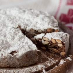 Panforte, a Medioeval spicy Christmas cake from Tuscany, made with almonds, candied fruit and honey