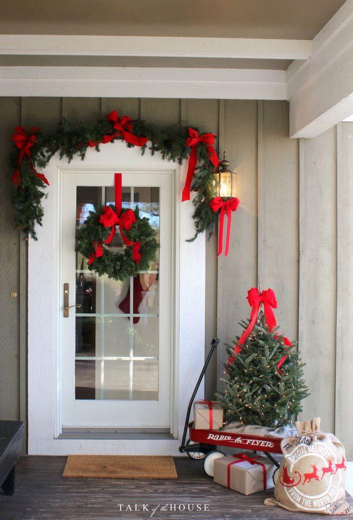 door Christmas decorating tree in wagon More