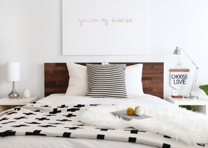 IKEA has an amazing product called Stikwood that can turn a simple white headboard into a beautiful faux wood statement piece. Stikwood Headboard
