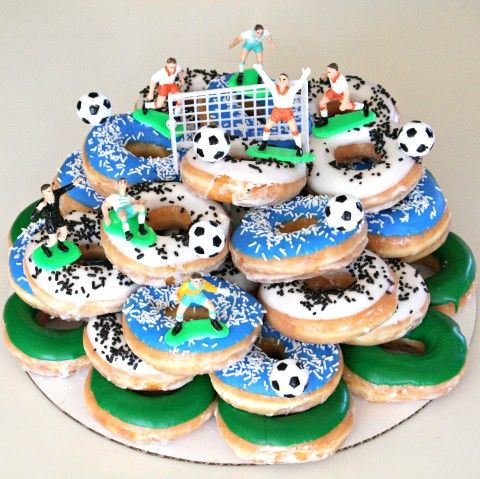 This ended up being the best birthday cake. EVER! 10-yr-old boy party. See it all here: http://www.shockinglydelicious.com/donut-cake/