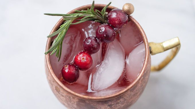 Fresh herbs muddled with sugar and topped with ginger beer, vodka and cranberry juice. Garnished with a skewer of sugared cranberries, this festive cocktail is sure to spread the holiday cheer.