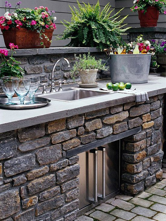 outdoor sink/grill/storage  Katie something like this is very do-able on ya'll's patio.  You wouldn't want built in obviously but could piece together from used kitchen cabinets with a skim coat of concrete I think.  Love the herbs, flowers on the ledge etc.