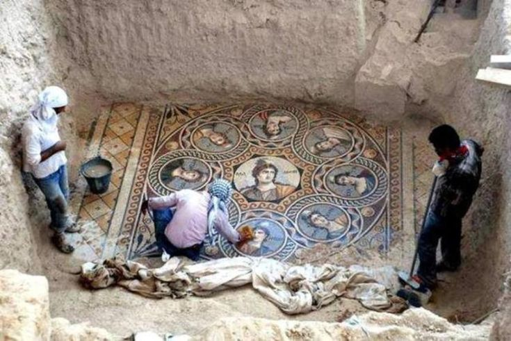 Workers clear a mosaic depicting the nine Muses   Archaeologists Unearth Three Ancient Greek Mosaics in the Ongoing Excavation in Zeugma, Turkey - laughingsquid.com