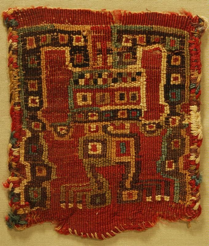 Huari or Wari Textile Panel Ca 500 AD.Peru Woven in slit tapestry technique with a central oculate being holding serpents springing from his head. Vivid colors in red, brown, ochre, cream and umber.