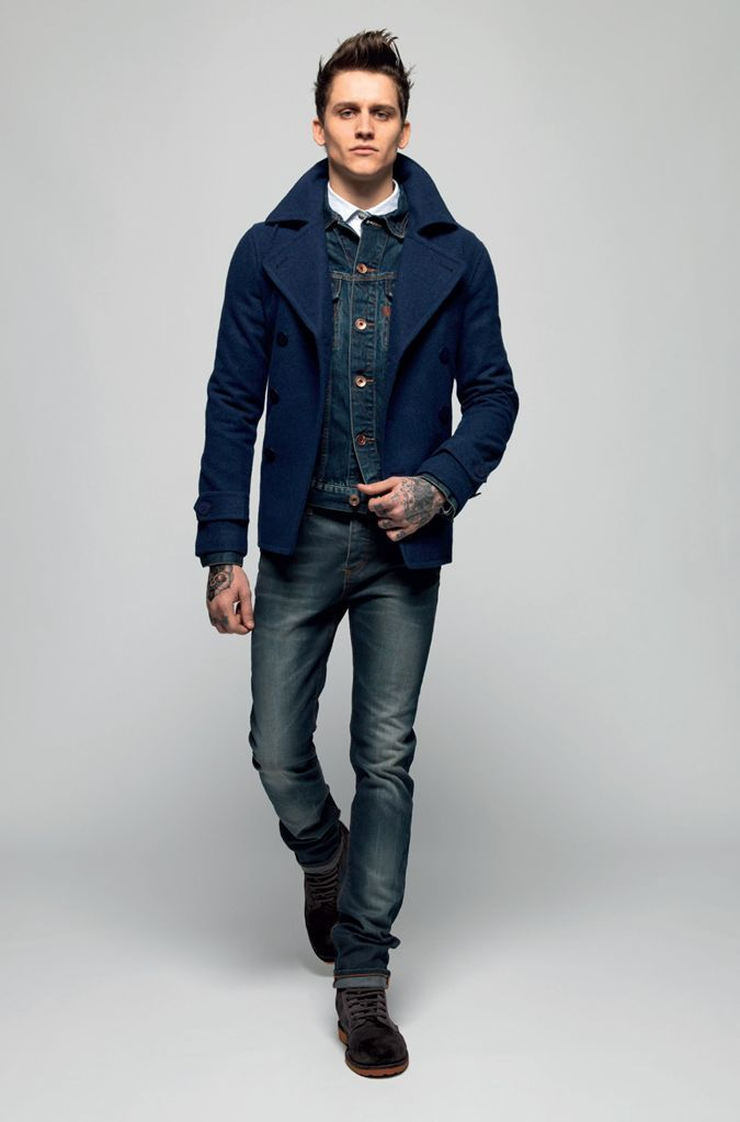 A navy pea coat and navy blue slim jeans are a great outfit formula to have in your arsenal. Round off this look with dark brown suede desert boots.   Shop this look on Lookastic: https://lookastic.com/men/looks/pea-coat-denim-jacket-long-sleeve-shirt/14375   — White Long Sleeve Shirt  — Navy Denim Jacket  — Navy Pea Coat  — Navy Skinny Jeans  — Dark Brown Suede Desert Boots