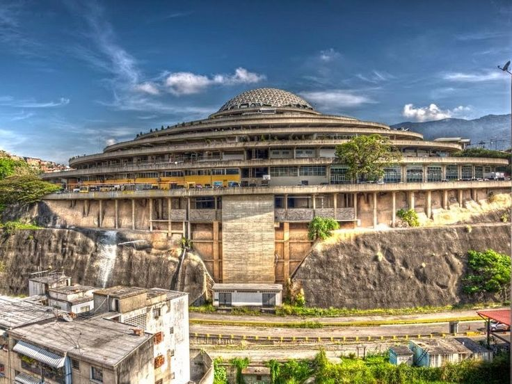 The world's first planned drive-through mall is now a prison — take a look at its history - Amongst the small houses on a hill in Caracas, Venezuela, the massive Helicoide looks otherworldly — or at the very least, out of place.  The spaceship-like building was originally planned as a drive-through mall. Instead of walking, shoppers would have been able to drive right into the complex and park in front of the shops they wantedto visit.(Though, the shops wouldn't have drive-through…