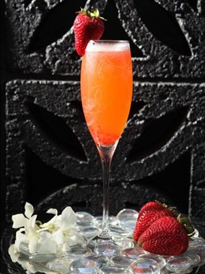 A delicious recipe for a Chic Cocktail made with Vodka and Champagne. Don't forget the strawberry...