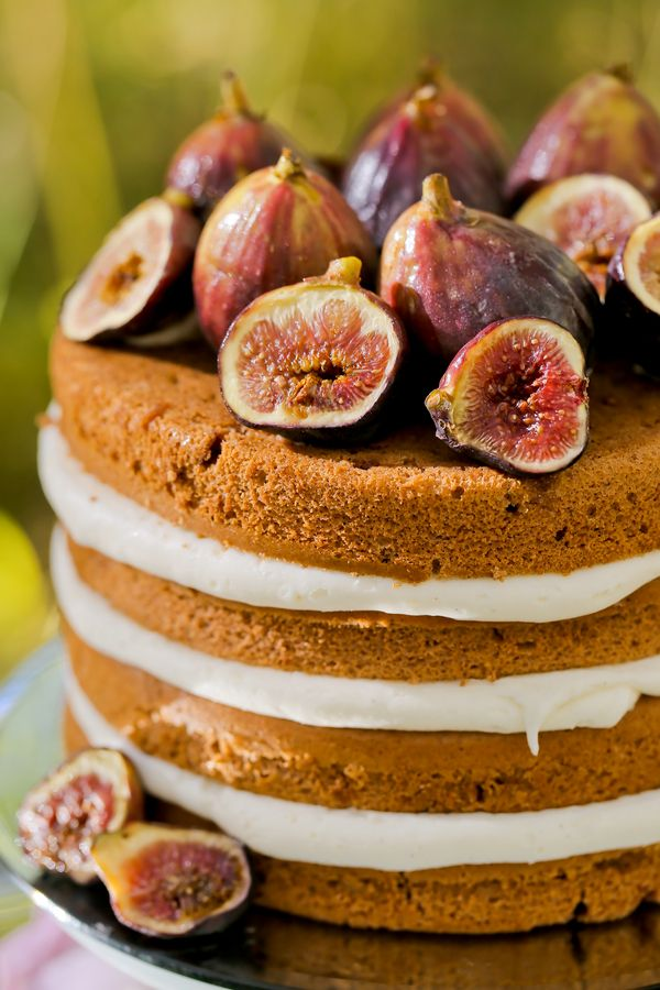 A naked cake adorned with figs is a simple yet elegant addition to a fall wedding dessert table. | Pepper Nix Photography