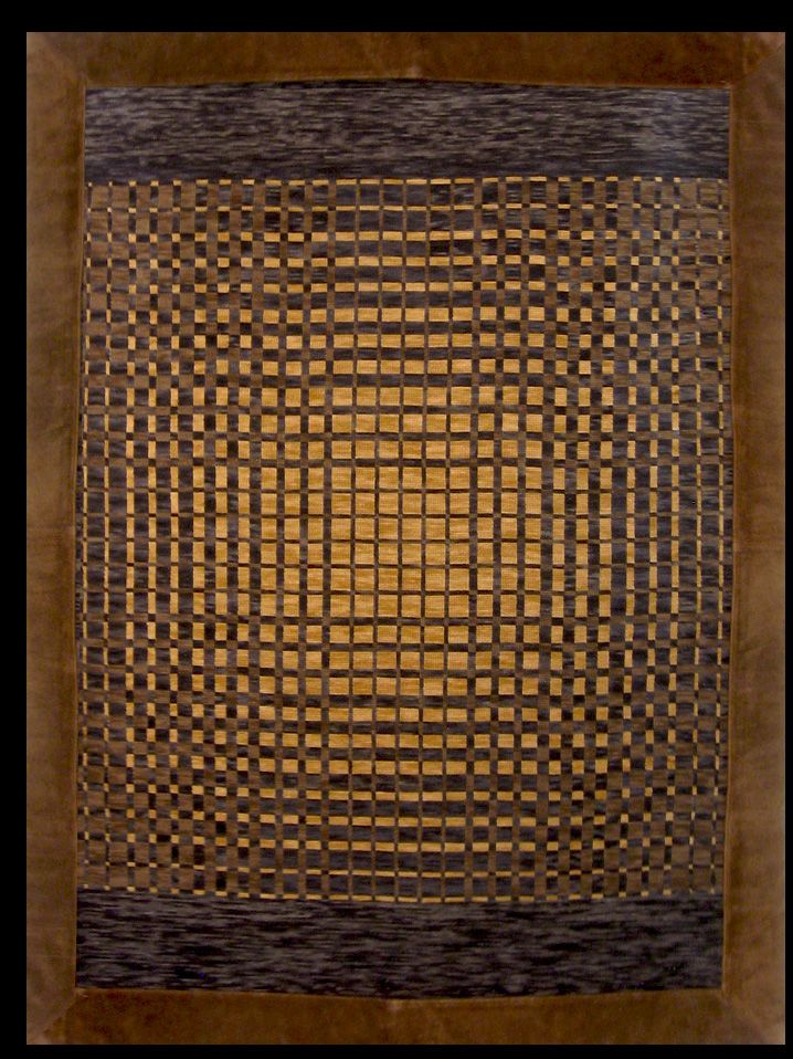 Ventas Online:  Online Sales: www.gogoanhalzer.com http://www.gogoanhalzer.com/en/products-page/rugs/danero/  DAMERO (RUG) This hand woven rug in arpillera with leather borders (10 cm.) was inspired by Pre-Colombian stamps. Made by Gogó Anhalzer.  DAMERO (ALFOMBRA) Bordado a mano en lana natural sobre arpillera, enmarcada con cuero (10 cm.). Realizado bajo la inspiración de sellos precolombinos por Gogó Anhalzer.