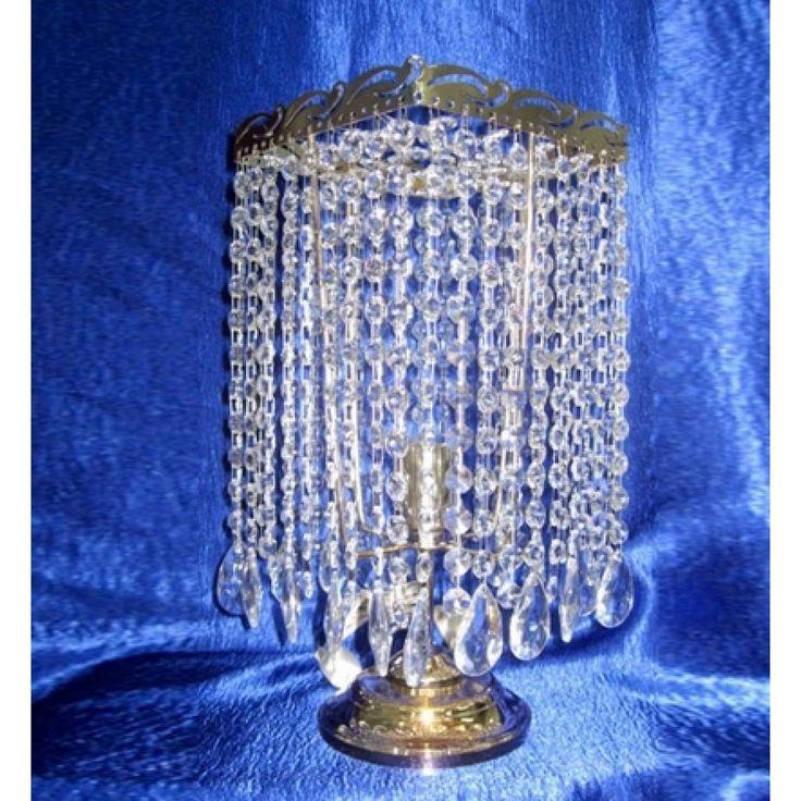 Настольная лампа Престиж Журавль с прозрачными подвесками. Цвет фурнитуры на выбор - золото или серебро. Оборудована выключателем на проводе. Хрустальная настольная лампа Престиж Журавль изготавливается в Гусь-Хрустальном по классическим технологиям. Она будет идеальным украшением вашей спальни.