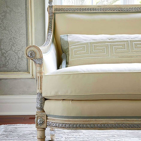 A Neoclassical Style Settee Is Upholstered In Creamy Ivory With Greek Key  Pattern Details And A Silver Leaf Finish   Traditional Home® / Photo:  Werner ...
