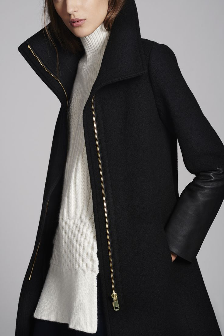 "clubmonaco: "" Speak volumes in a leather-trimmed coat with enveloping collar. """