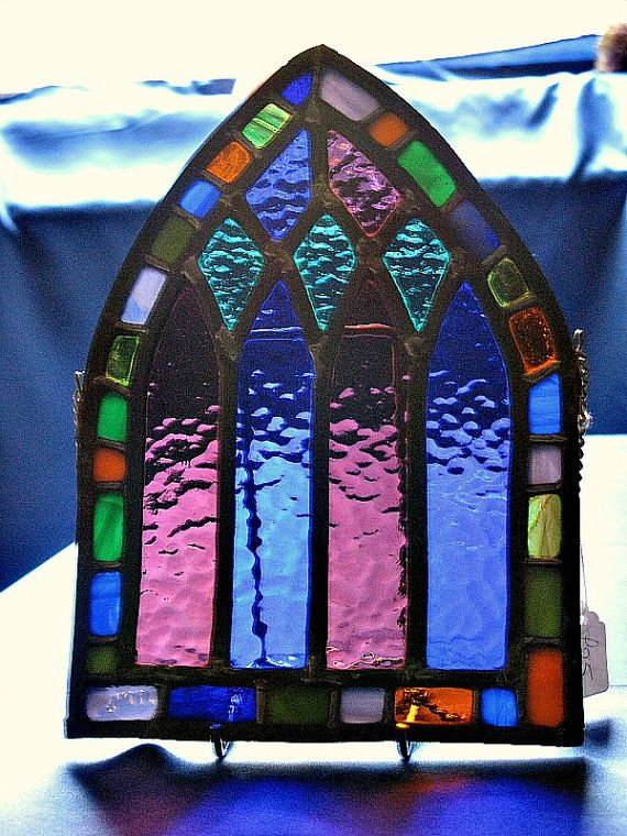 Stained glass arched church window - - - nice, and great way to get the shot!