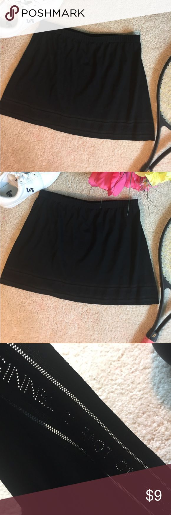 """TAIL"" Tennis Skirt Lightweight Lycra/poly/Nylon blend black tennis skirt. Dye cut hem edge with tennis score terms. Great condition. 36"" elastic waist (not stretched). 14"" length from waist to hem. Tail Skirts Mini"