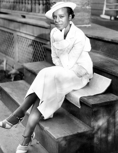 """1935, Cleveland, Ohio - Minnie Ruth Solomon waiting at the train station for her fiance, Olympic champion Jesse Owens on the eve of their wedding."""