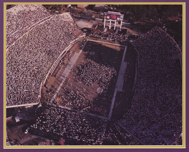 Overhead view of the crowd at Dowdy-Ficklen Stadium celebrating on the field as the Pirates defeat NC State by a score of 23 - 6 on November 20, 1999. Identifier: 55-02-0477. #DigitalArchives #ECU #NCState #NCHistory #JoynerLibrary #FunFactFriday
