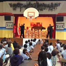 The curtains are drawn and the big reveal shows students at Brehms Lane Elementary School are about to get school supplies, funded for the entire year by the Baltimore Buick GMC's dealers generous support through their EducationAd buy with CBS EcoMedia.