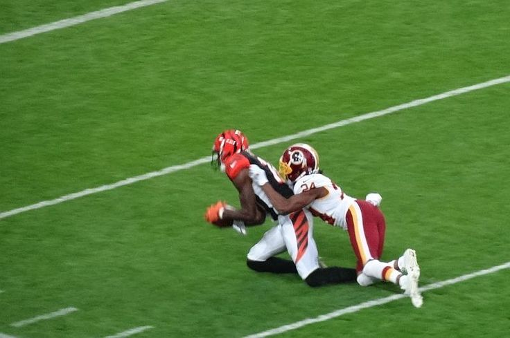 AJ Green makes the catch of the game over Josh Norman during the Redskins - Bengals NFL game at Wembley stadium.