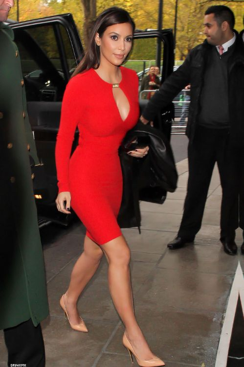 """I'm not crazy about Kim K., but I like some of her outfits.  That being said, the girl's curvy, and curvy does not scream """"18 inch waist,"""" no matter what the angle is."""
