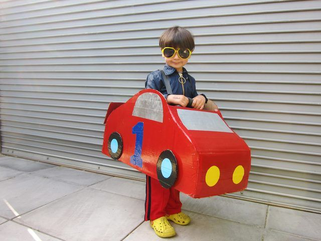 A fast and fun cardboard car costume easy to make with a couple cardboard boxes, red paint, and a hot glue gun.