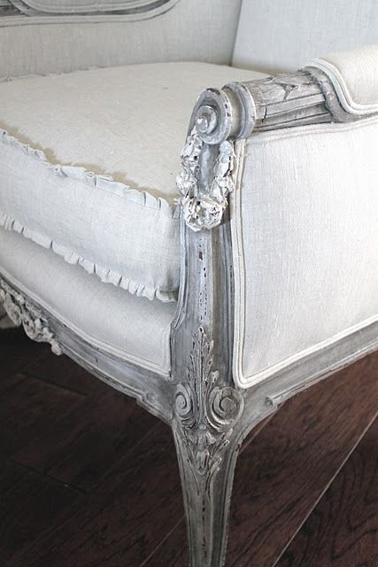 Aged gray antiqued finish with ruffled cushion.
