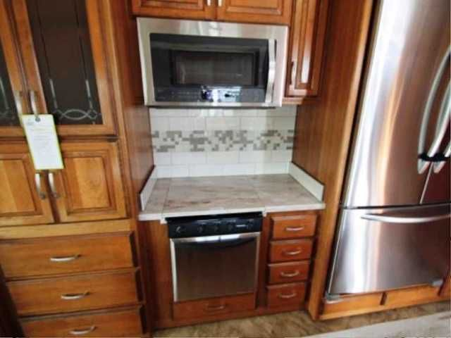 "2016 Used DRV Mobile Suites 36RSSB3 Fifth Wheel in Nevada NV.Recreational Vehicle, rv, Purchased 6/15... 2016 Mobile Suites 36RSSB3 5th Wheel Rear Living... Professionally Installed New ONAN QG5500 Propane RV Generator... 46"" Samsung TV & Home Theatre Package... 32"" Samsung Bedroom TV Package... 2 AC's... LR w/Heat Pump... Whole House Central Vacuum... Goodyear H Rated Tires w/Spare... Frameless Thermopane Windows... Deluxe Day Night Shades... Built in Fireplace... 3 Burner Cooktop... Magnum…"