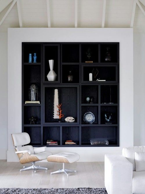The only thing to look at on this is idea is the different sized & shaped shelves. these will fit in either side of your stud wall chimney breast. The odd one will have spot lighting in. This room is very large with no feature or wow in it ( apart from the stunning view from your French doors). This wall will bring in warmth and add a feel/feature to the room.