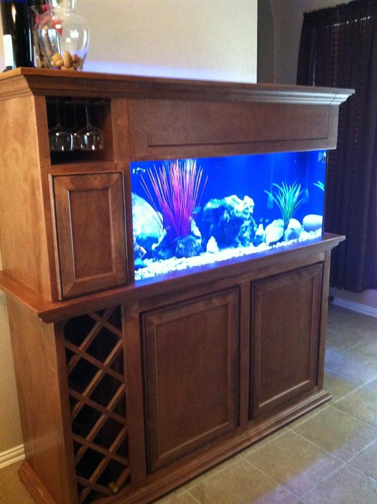 Custom fish tank. Wine rack and glass holder on the side.