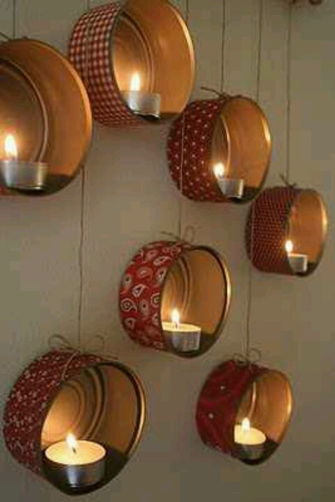 Large tuna cans, little votives, paint the inside, ribbon or scrap book paper outside! Arrange in groupings...cutie on the cheap...upcycle!