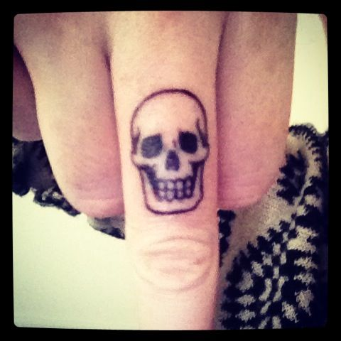 Awesome skull knuckle tattoo
