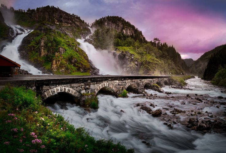 Låtefossen is a gorgeous unique looking double waterfall in Norway. It's such an interesting spot to visit that I had to shoot it. All in all Norway has made a long term impression on me with its undeniable beauty.   This shot is made of two shots to get detail in the shadows and in highlights. I tried different shutter speeds to get the most pleasing look out of the water for me.