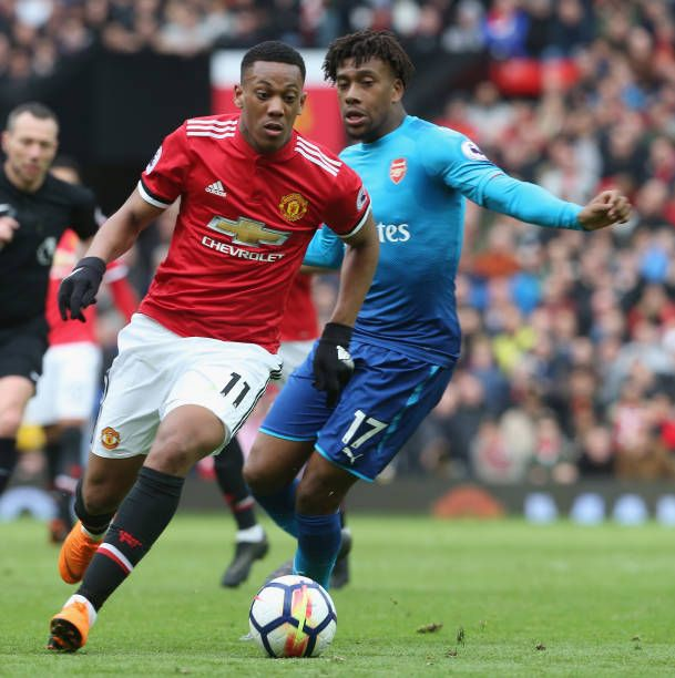 Anthony Martial Of Manchester United In Action With Alex Iwobi Of