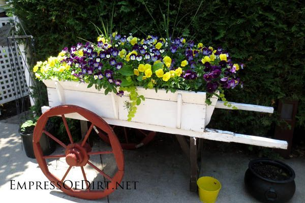 Creative DIY garden containers -  repurposed wooden wagon with flowers
