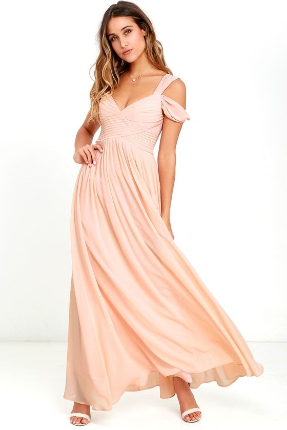 You'll be the hit of any dance floor in the Make Me Move Blush Pink Maxi Dress! Double shoulder straps lead into a gathered surplice bodice with a sweetheart neckline. Pleated empire waist flows into an elegant woven maxi skirt. Hidden back zipper with clasp.